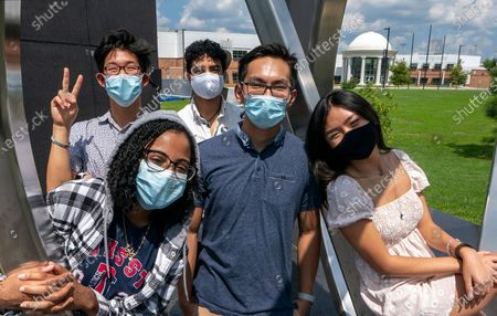 Rising seniors at the Thomas Jefferson High School for Science and Technology gather on the campus in Alexandria, Va., . From left in front are, Dinan Elsyad, 17, Sean Nguyen, 16, and Tiffany Ji, 17. From left at rear are, Jordan Lee, 17, and Shibli Nomani, 17
