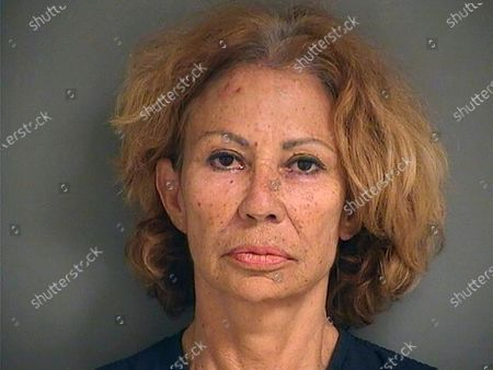 Photo provided by the Palm Beach County Sheriff's Office shows Renata Gloria Ray, who authorities say shot and wounded one woman and threatened another following a confrontation outside a grocery store Sunday afternoon, in Lake Worth, Fla. Ray was arrested shortly after the shooting outside a Publix, the Palm Beach County Sheriff's Office said. She was charged with attempted murder and aggravated assault with a firearm
