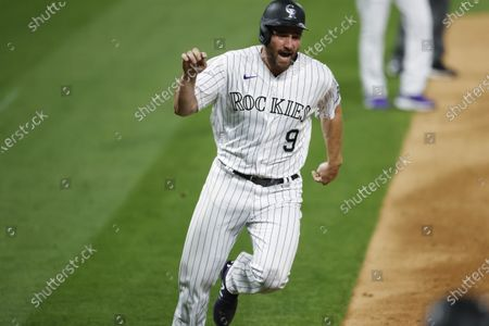 Colorado Rockies' Daniel Murphy scores on a double by Raimel Tapia off Arizona Diamondbacks starting pitcher Alex Young during the eighth inning of a baseball game, in Denver. The Rockies won 8-7