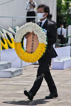 Leader of the Democratic Party for the People, Yuichiro Tamaki offers wreath during the ceremony for the atomic bomb victims marking the 75th anniversary of the atomic bombing of Nagasaki at the Peace Park in Nagasaki, Japan.