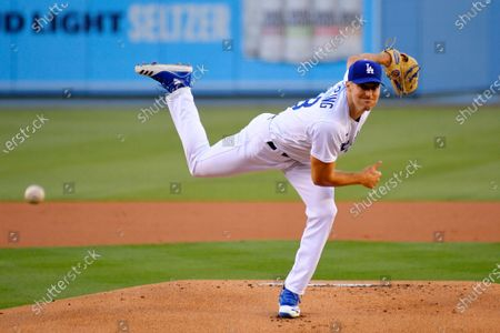 Los Angeles Dodgers starting pitcher Ross Stripling throws to the plate during the first inning of a baseball game against the San Diego Padres, in Los Angeles