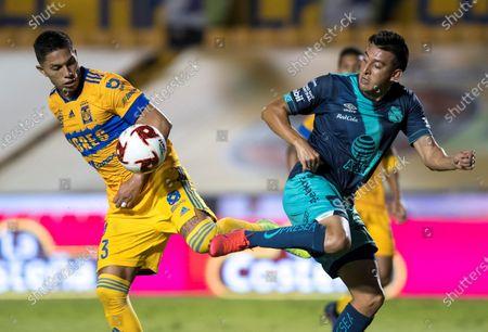Carlos Salcedo (L) of Tigres in action against Daniel Alvarez of Puebla during a 2020 Guardians of Mexico soccer tournament match between Tigres and Puebla at Estadio Universitario in Monterrey, Mexico, 11 August 2020.