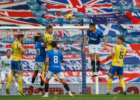 Leon Balogun heads the ball clear above Jason Kerr of St. Johnstone during the Scottish Premiership match between Rangers & St. Johnstone at Ibrox Stadium, Glasgow on 12th August 2020.