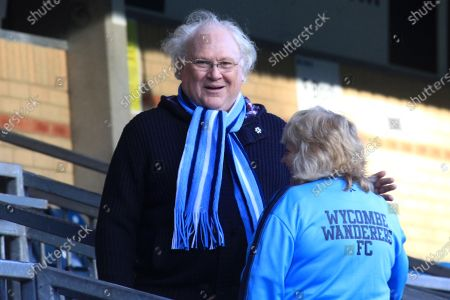 Wycombe Wanderers supporter, Colin Baker, arrives at the ground and chats with a member of staff ahead of kick-off. Colin was the sixth incarnation of the Doctor in the long running science fiction series Doctor Who from 1984 to 1986 during Wycombe Wanderers vs Exeter City, NPower League Two Football at Adams Park on 1st January 2013