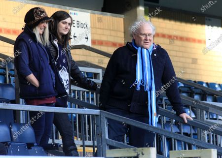 Wycombe Wanderers supporter, Colin Baker along with his family take an early look at the pitch from the main stand ahead of kick-off. Colin was the sixth incarnation of the Doctor in the long running science fiction series Doctor Who from 1984 to 1986 during Wycombe Wanderers vs Exeter City, NPower League Two Football at Adams Park on 1st January 2013