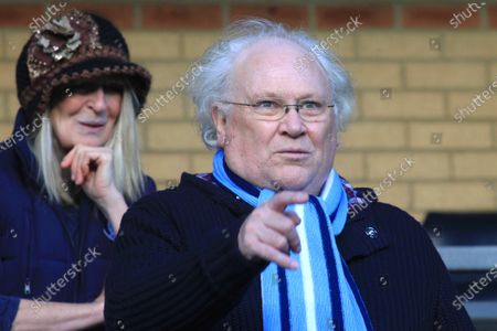 Wycombe Wanderers supporter, Colin Baker takes an early look at the pitch from the main stand ahead of kick-off. Colin was the sixth incarnation of the Doctor in the long running science fiction series Doctor Who from 1984 to 1986 during Wycombe Wanderers vs Exeter City, NPower League Two Football at Adams Park on 1st January 2013