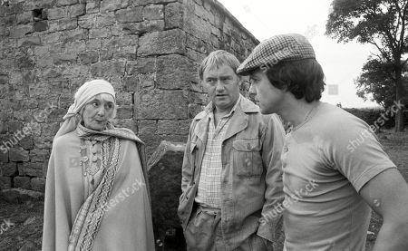 Stock Image of Emmerdale Farm - Ep 545 Tuesday 15th January 1980 Enid disapproves of Matt and Joe's rough handling of an injured sheep. With Enid Pottle, as played by Anne Dyson ; Joe Sugden, as played by Frazer Hines ; Matt Skilbeck, as played by Frederick Pyne.