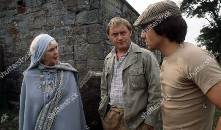 Stock Picture of Emmerdale Farm - Ep 545 Tuesday 15th January 1980 Enid disapproves of Matt and Joe's rough handling of an injured sheep. With Enid Pottle, as played by Anne Dyson ; Joe Sugden, as played by Frazer Hines ; Matt Skilbeck, as played by Frederick Pyne.