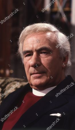 Stock Picture of Emmerdale Farm - Ep 575 Tuesday 29th April 1980 The Bishop visits Hinton. Hinton says he seems to think he is treated as a social worker as well as a vicar. With The Bishop, as played by Ronald Leigh Hunt.