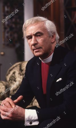 Stock Image of Emmerdale Farm - Ep 575 Tuesday 29th April 1980 The Bishop visits Hinton. Hinton says he seems to think he is treated as a social worker as well as a vicar. With The Bishop, as played by Ronald Leigh Hunt.