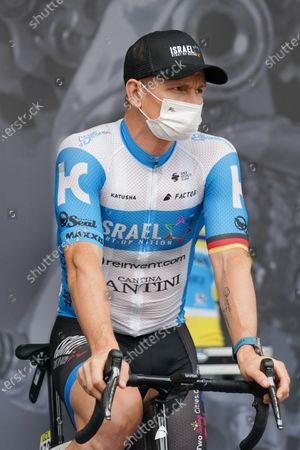 German rider Andre Greipel of Israel-Start-Up nation with protective mask at the start of the 1st stage of the Criterium du Dauphine cycling race over 218.5km between Clermont-Ferrand and Saint Christo en Jarrez, France, 12 August 2020.