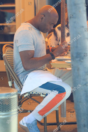 Stock Picture of Anderson Silva sits in a cafe