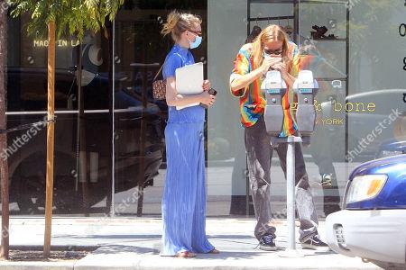 Samara Weaving walks on the street