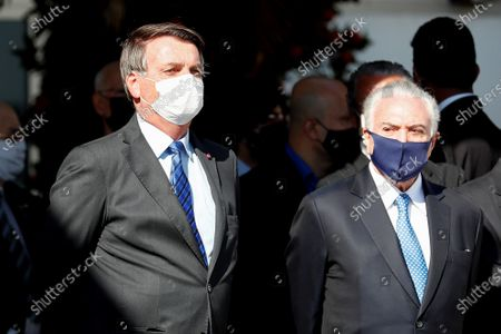 Brazilian President Jair Bolsonaro (L) and former President Michel Temer (R) participate in the act prior to the departure of a plane bound for Lebanon with basic medicines and health supplies, at the Sao Paulo Air Base, Brazil, 12 August 2020. Brazil sent a mission to Lebanon on Wednesday with about six tons of food and medical supplies after the devastating explosion that struck the port of Beirut last week, leaving 171 dead and more than 6,000 injured so far.