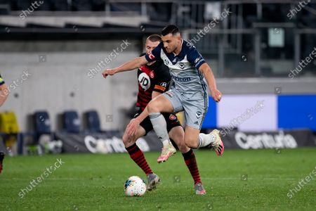 Melbourne Victory forward Andrew Nabbout (9) controls the ball