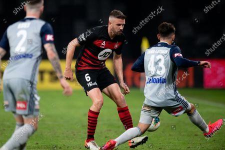 Stock Photo of Western Sydney Wanderers defender Matthew Jurman (6) controls the ball