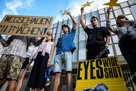 People stand in front of the German Embassy in Sofia, Bulgaria, 12 August 2020, with their eyes closed as part of an anti-government protest. The demonstration is related to the words of the leader of the European People's Party in the European Parliament Manfred Weber that EPP support current Bulgarian government of Boyko Borrisov in the fight against corruption.