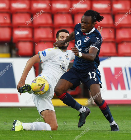 Ross County's Regan Charles-Cook is challenged by Gary Dicker