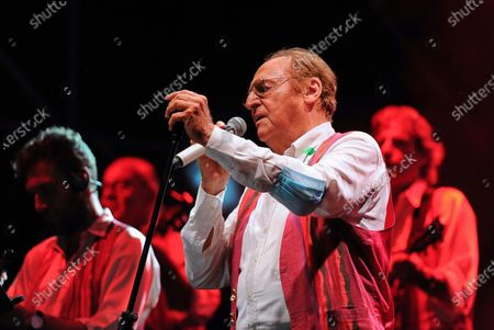 Stock Photo of On the Prairie of the Portici Palace, the highly anticipated concert by Renzo Arbore accompanied by his Italian Apulian Orchestra by birth but Neapolitan by adoption, since 1992 he has been carrying out a project to enhance the Neapolitan classical song with his own personal way of understanding music.