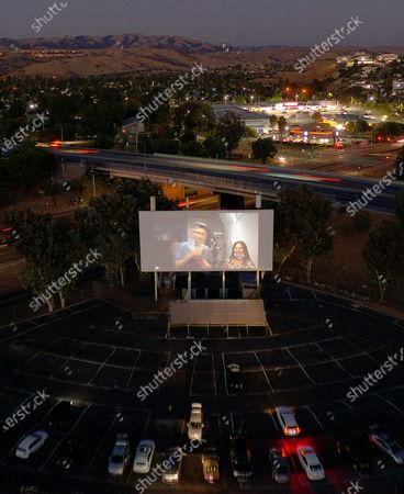 Stock Image of Filmmakers Amanda McBaine and Jesse Moss introduce the film from the projection booth during A24 Studio's Special Screening of 'Boys State' at West Wind Capitol