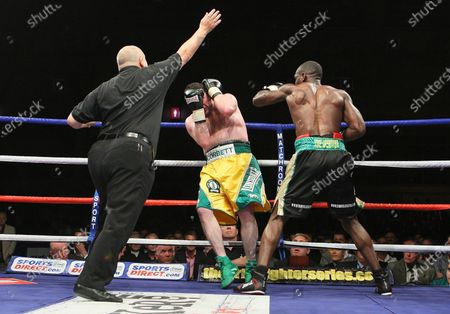 Ovill McKenzie (Canning Town, black shorts) defeats Darren Corbett (Belfast, yellow/green shorts), Semi-Final of Prizefighter 'The Cruiserweights' Boxing contest at Earls Court, London promoted by Barry Hearn / Matchroom Sports