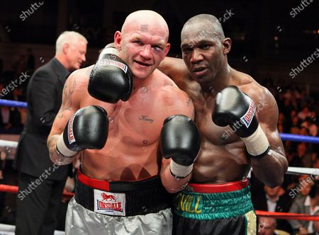 Stock Photo of Ovill McKenzie (Canning Town, black shorts) defeats John 'Buster' Keeton (Sheffield, silver/grey shorts) to win the Final of Prizefighter 'The Cruiserweights' Boxing contest at Earls Court, London promoted by Barry Hearn / Matchroom Sports