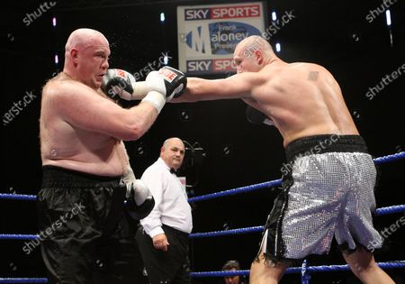 Belshaw with trainer Brian Lawrence  Scott Belshaw (Lisburn, silver shorts) defeats Daniel Peret (Trondheim, black shorts) in a Heavyweight contest at Goresbrook Leisure Centre, Dagenham, Essex promoted by Frank Maloney / FTM SportsScott Belshaw (Lisburn, silver shorts) defeats Daniel Peret (Trondheim, black shorts) in a Heavyweight contest at Goresbrook Leisure Centre, Dagenham, Essex promoted by Frank Maloney / FTM Sports