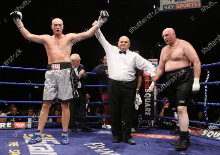 Stock Photo of Belshaw with trainer Brian Lawrence  Scott Belshaw (Lisburn, silver shorts) defeats Daniel Peret (Trondheim, black shorts) in a Heavyweight contest at Goresbrook Leisure Centre, Dagenham, Essex promoted by Frank Maloney / FTM SportsScott Belshaw (Lisburn, silver shorts) defeats Daniel Peret (Trondheim, black shorts) in a Heavyweight contest at Goresbrook Leisure Centre, Dagenham, Essex promoted by Frank Maloney / FTM Sports
