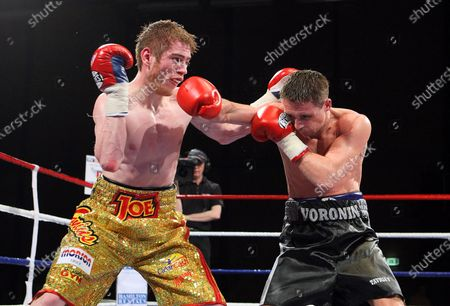 Stock Picture of Joe Murray (gold shorts) defeats Yuri Voronin in a Super-Bantamweight boxing contest at Goresbrook Leisure Centre, Dagenham promoted by Ricky Hatton