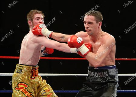 Joe Murray (gold shorts) defeats Yuri Voronin in a Super-Bantamweight boxing contest at Goresbrook Leisure Centre, Dagenham promoted by Ricky Hatton