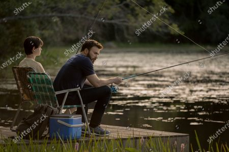 Stock Photo of Jaeden Lieberher as Jacob Barber and Chris Evans as Andy Barber