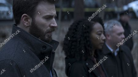 Stock Image of Chris Evans as Andy Barber and Betty Gabriel as Pam Duffy