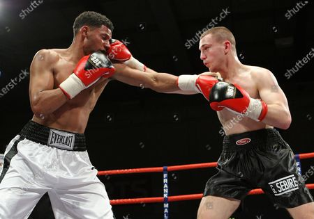 Christopher Sebire (France, black shorts) defeats Robert Lloyd Taylor (Staines, white shorts) in a Welterweight contest at Newham Leisure Centre, promoted by Frank Maloney