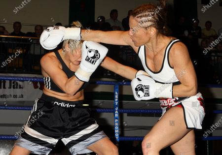 Laura Saperstein (white shorts) defeats Lana Cooper in a Super-Featherweight boxing contest at York Hall, Bethnal Green, promoted by Miranda Carter / Left Jab