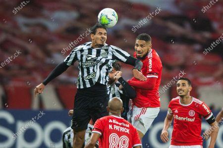 Paolo Guerrero of Internacional loses the header to Lucas Veríssimo of Santos; Estadio Beira Rio, Porto Alegre, Brazil; Brazilian Serie A, Internacional versus Santos.