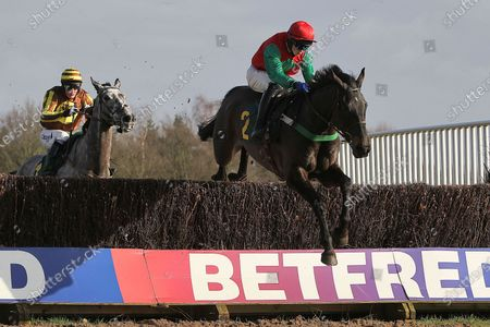 Race winner Ballypatrick ridden by Conor O'Farrell (red cap) in jumping action in the Andy Don Memorial Beginners Chase