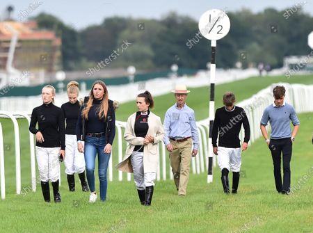 (C-panama hat) John Reid, jockey coach, accompanies apprentice jockeys on a course walk during racing.Photo © Hugh Routledge.