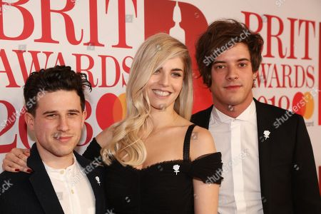 Stock Picture of London Grammar - Dan Rothman, Hannah Reidand and Dot Major attend The BRIT Awards 2018 Red Carpet