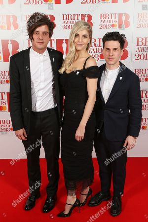 Stock Photo of London Grammar - Dot Major, Hannah Reid and Dan Rothman attend The BRIT Awards 2018 Red Carpet