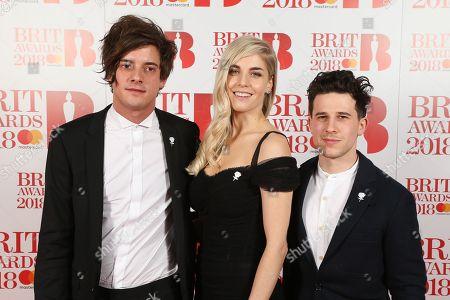 Stock Image of London Grammar - Dot Major, Hannah Reid and Dan Rothman attend The BRIT Awards 2018 Red Carpet