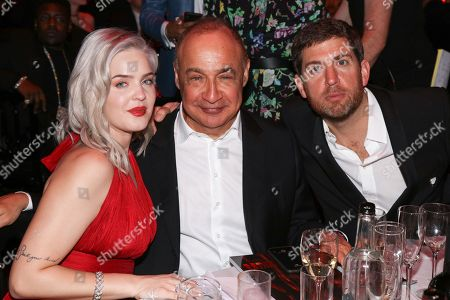 Anne-Marie with Len Blavatnik and Max Lousad at their area floor at table ,The BRIT Awards 2018