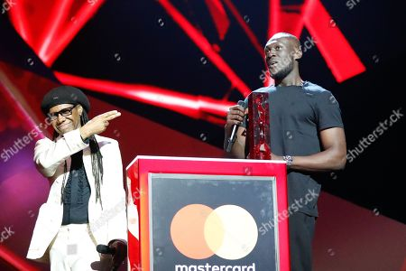 Nile Rogers (L) presents the British Album of the Year award to Stormzy at The BRIT Awards 2018