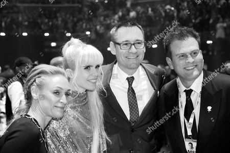 Paloma Faith and Jason Iley pose with guests on the area floor at The BRIT Awards 2018