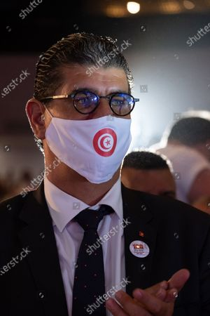 Mohamed Karim Krifa ldeputy of The Free Dostour Party (PDL) attends the public meeting wearing a Tunisian flag face mask.