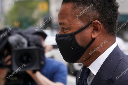 Cuba Gooding Jr. arrives to court for a hearing in his sexual misconduct case, in New York. A judge ordered the courtroom outfitted with Plexiglas and other measures to prevent the spread of the coronavirus, which has delayed the trial indefinitely