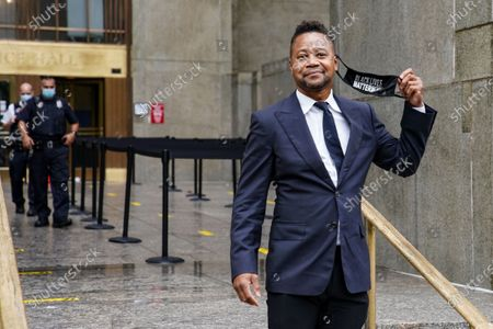 Cuba Gooding Jr. smiles as he leaves court after a hearing in his sexual misconduct case, in New York. A judge ordered the courtroom outfitted with Plexiglas and other measures to prevent the spread of the coronavirus, which has delayed the trial indefinitely