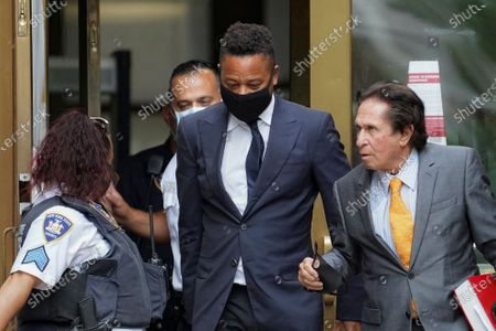 Cuba Gooding Jr., center, and his attorney Mark J. Heller, right, leave court after a hearing in his Gooding's sexual misconduct case, in New York. A judge ordered the courtroom outfitted with Plexiglas and other measures to prevent the spread of the coronavirus, which has delayed the trial indefinitely
