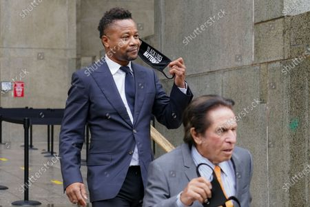 Cuba Gooding Jr., left, and his attorney Mark J. Heller, right, leave court after a hearing in Gooding's sexual misconduct case, in New York. A judge ordered the courtroom outfitted with Plexiglas and other measures to prevent the spread of the coronavirus, which has delayed the trial indefinitely