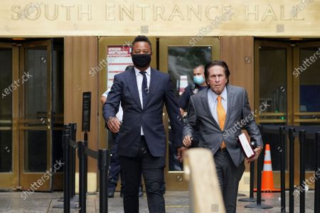 Cuba Gooding Jr., left, and his attorney Mark J. Heller, right, leave court after a hearing in his Gooding's sexual misconduct case, in New York. A judge ordered the courtroom outfitted with Plexiglas and other measures to prevent the spread of the coronavirus, which has delayed the trial indefinitely
