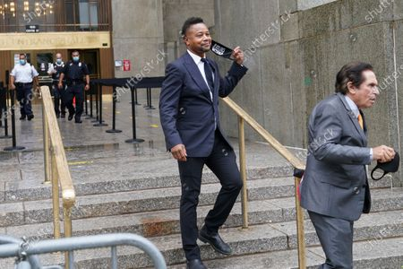 Stock Picture of Cuba Gooding Jr., left, and his attorney Mark J. Heller, right, leave court after a hearing in his Gooding's sexual misconduct case, in New York. A judge ordered the courtroom outfitted with Plexiglas and other measures to prevent the spread of the coronavirus, which has delayed the trial indefinitely